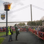 Lit beacon and crowds on Hessle foreshore